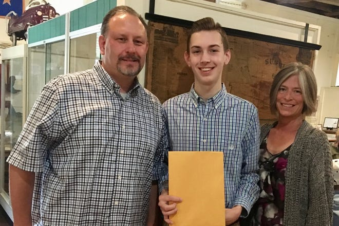 Volunteer Drew Baird and his parents at the Twinsburg Historical Society.