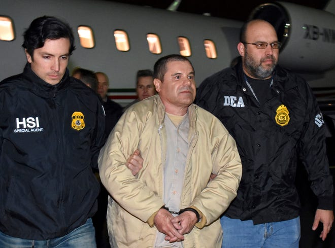 "Authorities escort Mexican drug lord Joaquin ""El Chapo"" Guzman, center, from a plane in Ronkonkoma, N.Y., in January 2017. On Friday, Guzman's attorneys filed an appeal to his U.S. conspiracy conviction. They cited the judge's rulings that allowed a jury to hear faulty evidence at his trial, as well as reports that before reaching a guilty verdict, some jurors sought out news accounts about sex abuse allegations against him that were barred from the trial."