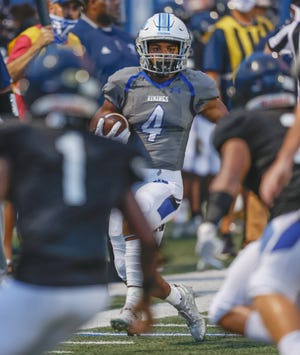 Lakeland Christian's E.J. Vickers breaks into the open after snagging an interception against St. John Paul II's Tremaine Hughes on Friday night in Lakeland.