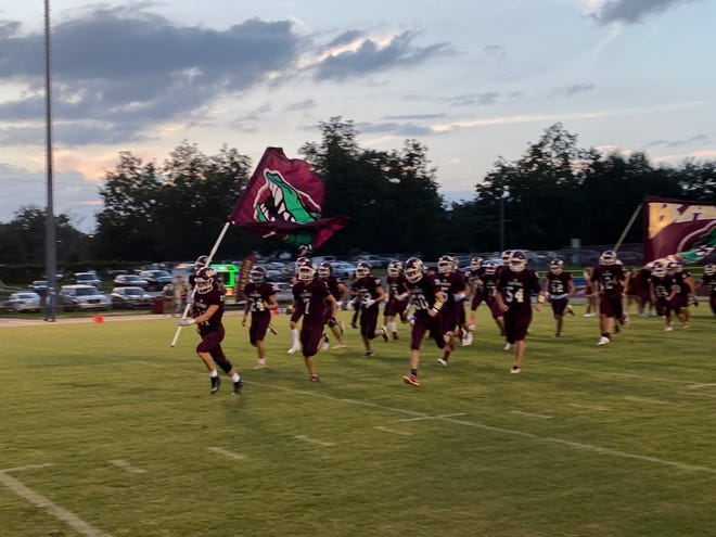 Baker takes the field against Lighthouse Private Christian Academy on Friday night.