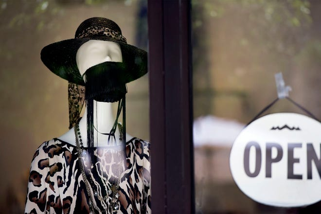 A mannequin at Sabella Mikesell Couture wears a mask in July. [MEGHAN MCCARTHY/palmbeachdailynews.com]
