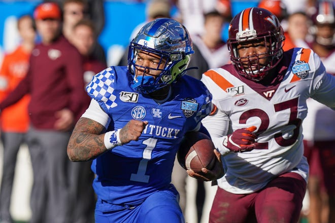 Kentucky QB Lynn Bowden Jr. runs against Virginia Tech's Rayshard Ashby in the Belk Bowl. [Jim Dedmon-USA Today Sports]