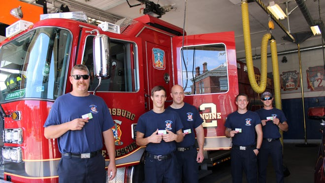 City of Petersburg Fire, Rescue, and Emergency Services firefighters at Station #2 on South Market Street from left to right, Philip Pugh, Owen Ramsey, Bobby Puryear, Chris Sheehy, and Brent Bailey hold up Local Vibe Café meal cards on Sept. 3, 2020 presented to them by philanthropist Bill Nicholson of Petersburg.