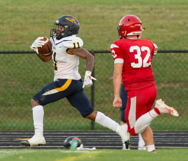 Field hosted Streetsboro, the Rockets won 35-0. Ritchell McCallister goes for a touchdown, Zachary Davis on defense.