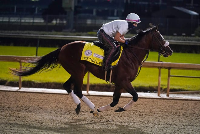 Kentucky Derby favorite Tiz the Law goes through a workout at Churchill Downs on Friday in Louisville, Ky. The Kentucky Derby is scheduled for Saturday. (AP Photo/Darron Cummings)