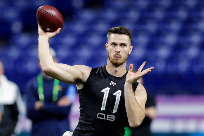 Oregon State quarterback Jake Luton throws a pass at the NFL combine in Indianapolis on Feb. 27. Luton was a sixth-round draft pick of the Jacksonville Jaguars and the ninth quarterback selected in the draft. (AP Photo/Michael Conroy)