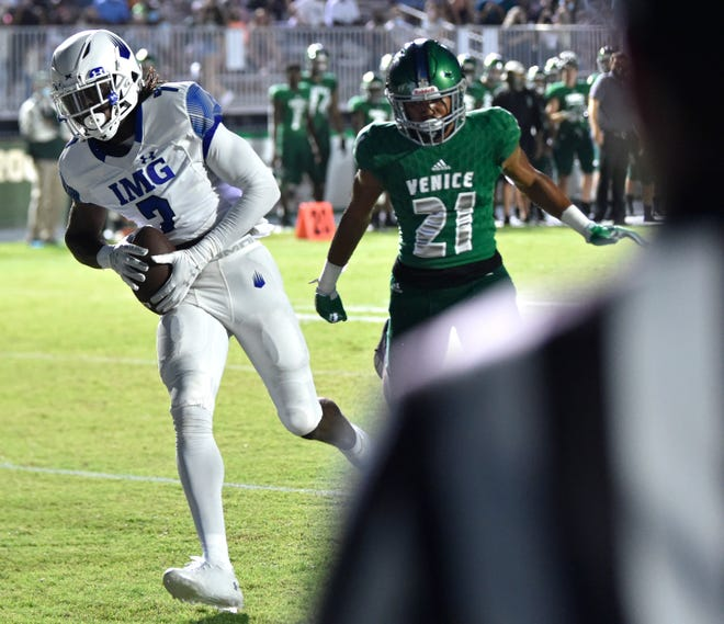 IMG's wide receive (7) Jacorey Brooks scores a touchdown against the Venice Indians Friday night September 4, 2020, at the Powell-Davis Stadium in Venice Florida.