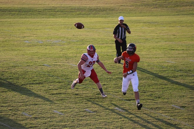 Maud quarterback Bryce Bodkin (5) delivers a pass Friday night against Fox.