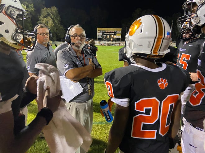 Trenton football coach Bill Wiles analyzes the Tigers' tentative lead in the fourth quarter of Friday night's season opener vs. P.K. Yonge. Trenton won 26-23 in overtime