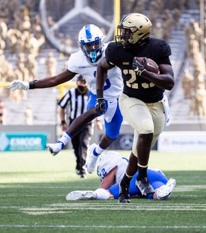 Anthony Adkins scored Army's last touchdown on a 22-yard run in the fourth quarter. The Black Knights defeated Middle Tennessee 42-0 in its season opener before a cadet-only crowd. DUSTIN SATLOFF/ARMY ATHLETICS