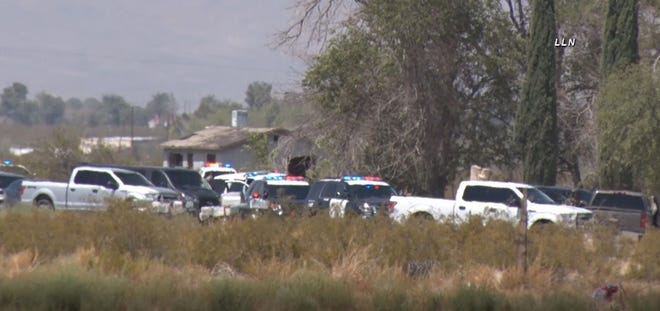 This screen grab from video shows San Bernardino County Sheriff's Department vehicles outside Moss Mobile Manor & RV Park on Friday, Sept. 4, 2020, during an active shooter incident.