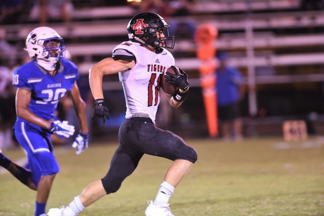 Anson's Riley Pippin (11) breaks into the open field for a 64-yard touchdown run against Coleman last season at Hufford Field in Coleman. The Tigers pulled away in the second half for a 38-14 victory.