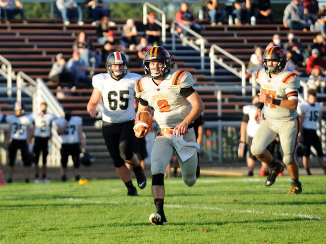 Gabe Tingle runs through open field during Ridgewood's 42-12 win against visiting Zoarville Tuscarawas Valley on Friday in an Inter-Valley Conference game in West Lafayette. Tingle, a junior, passed for 120 yards and ran for 66.