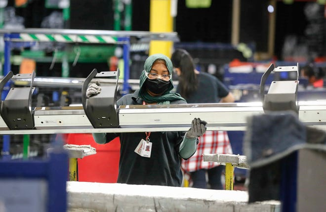 Employees at Dee Zee Manufacturing in Des Moines work on Friday, Sept. 4, 2020.