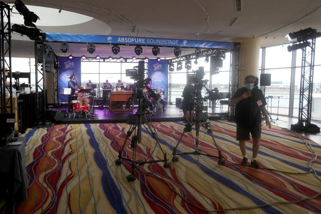 The crew prepares for Dr. Prof. Leonard King and his Orchestra to perform on the Absopure Sound Stage during the Detroit Jazz Festival held at the Renaissance Center on September 5, 2020.