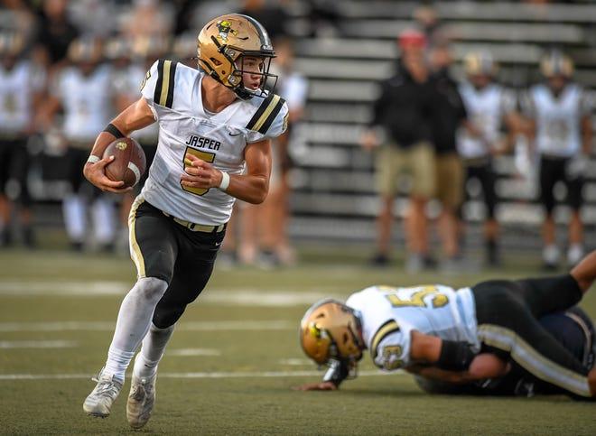 Jasper quarterback Blake Mann (5) on a first half scoring run as the Reitz Panthers host the Jasper Wildcats at the Reitz Bowl Friday, September 4, 2020.