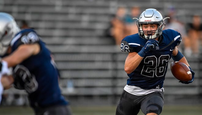 Reitz's Collin Brown (26) looks for running room as the Reitz Panthers host the Jasper Wildcats at the Reitz Bowl Friday, September 4, 2020.