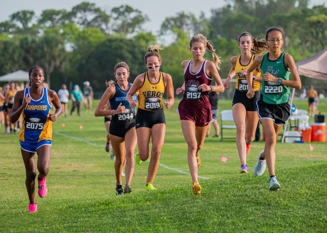Fort Myers' Amy Meng (2220), Bishop Verot's Kylie Thomas (2019) and FBA's Katie Beam (2197) lead a pack during the 41st Fort Myers Invite on Friday night at the Kelly Road Soccer Complex.