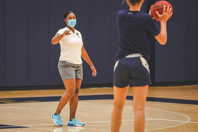 Notre Dame head women's basketball coach Niele Ivey, left, instructs during a preseason workout.