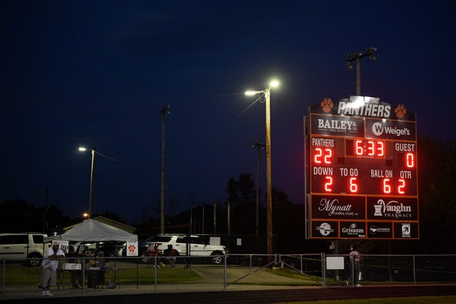 The scoreboard lit up during a football game between Powell and Fulton at Powell High School in Powell, Tenn. on Friday, Sept. 4, 2020.