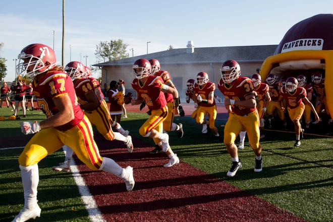 McCutcheon players take the field before the first quarter of an IHSAA football game, Friday, Sept. 4, 2020 in Lafayette.