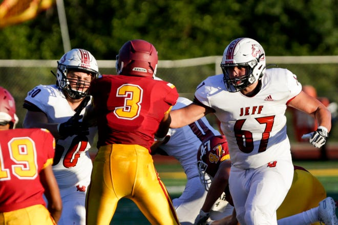 Lafayette Jeff's Colton Lehnen (50) and Lafayette Jeff's Jackson Hernandez (67) move to block McCutcheon's Leyton McGovern (3) during the first quarter of an IHSAA football game, Friday, Sept. 4, 2020 in Lafayette.
