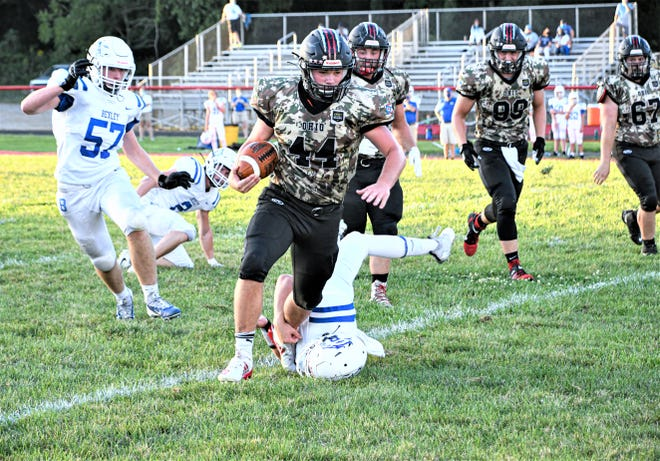Liberty Union running back Casey Fleahman runs the ball durning the first quarter Friday night in Baltimore, Ohio. Liberty Union prevailed by a score of 42-9.  Jamie Potts/The Lancaster Eagle Gazette