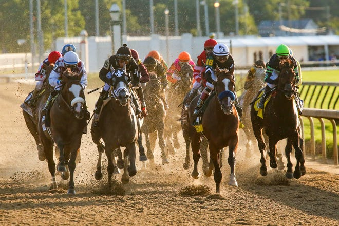 Authentic (18) led the field down the backstretch during the running of the 146th Kentucky Derby on Saturday, Sept. 5, 2020