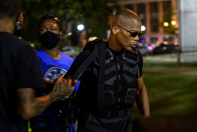 "John ""Grandmaster Jay"" Johnson, the leader of a Black militia called the Not F***ing Around Coalition (NFAC), walks through Jefferson Square Park in Downtown Louisville, Ky., Friday evening, Sept. 4, 2020. The NFAC traveled back to Louisville to protest the Kentucky Derby and demand justice for Breonna Taylor, an unarmed 26-year-old Black woman, who was fatally shot by police in her apartment on March 13."