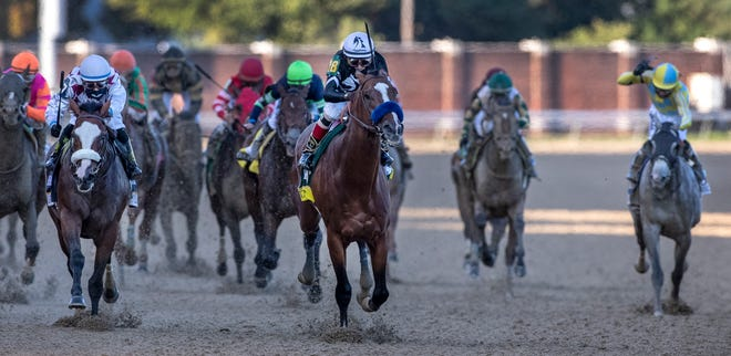 Authentic, trained by Bob Baffert, wins the 146th Kentucky Derby with jockey John Velazquez aboard. Sept. 5, 2020