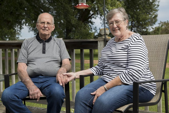 David and Ardis Freimund sit on their porch on Tuesday, Sept. 1, 2020, at their home outside of Spencer, Wis. Sept. 8 is the 30th anniversary of David's liver transplant.