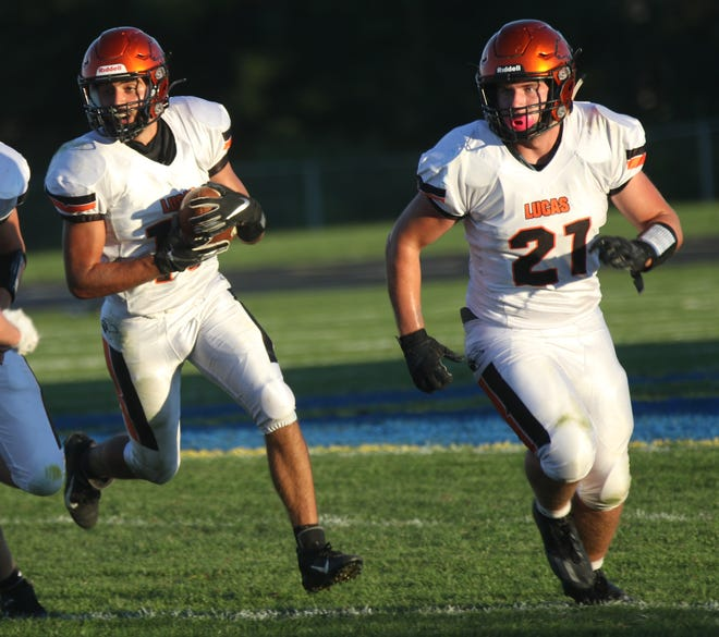 Lucas' Ethan Sauder (left) and Ethan Wallace (21) will be key figures in the outcome of Friday night's clash with Shelby.