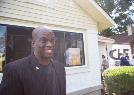 Chris Hope, founder of Chris Hope Foundation, poses outside the home that provides a place for people who have traveled to be with loved ones who are hospitalized in Memphis.