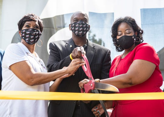 Founder Chris Hope, Viola Cage and Dr. Cheryl Fergerson cut a ribbon during a ceremony for the Chris Hope Home in Memphis on Sept. 5.
