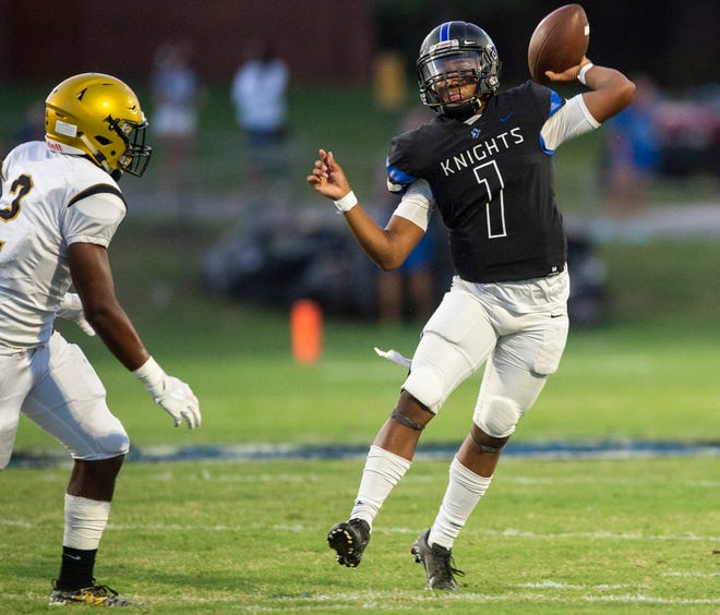 Catholic quarterback Caleb McCreary (1) throws throws the ball at Montgomery Catholic High School in Montgomery, Ala., on Friday, Sept. 4, 2020. Catholic leads Dadeville 20-0 at halftime.