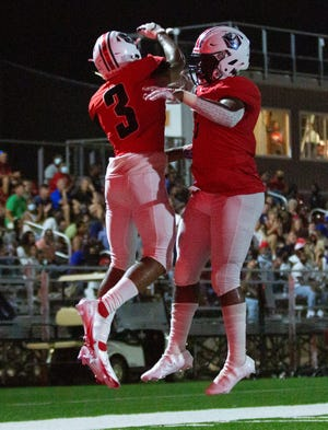 Pike Road wide receiver Harrison Wallace (3) celebrates his touchdown with a teammate during the second half.
