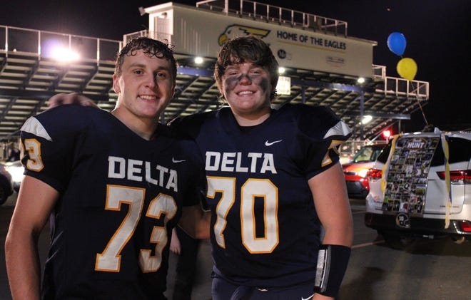 Delta seniors Braxton Edwards (left) and Riley Woodin (right) pose for a picture after a 68-0 win over Shelbyville Sept. 4, 2020.