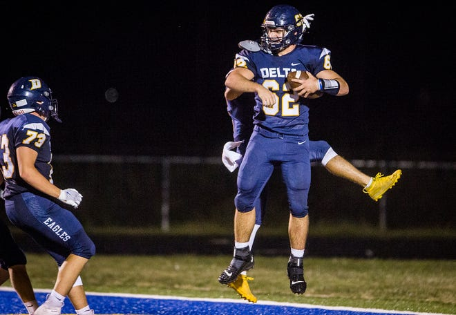 Delta's Evan Conley celebrates during the Eagles' 68-0 win against Shelbyville at Delta on Sept. 4, 2020. Conley helped guide Delta to a win against New Castle on Sept. 25, this time as a key running back for the Eagles.