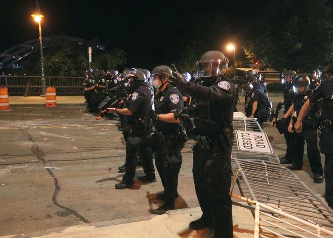 Rochester police begin to push back demonstrators on the Court Street Bridge.