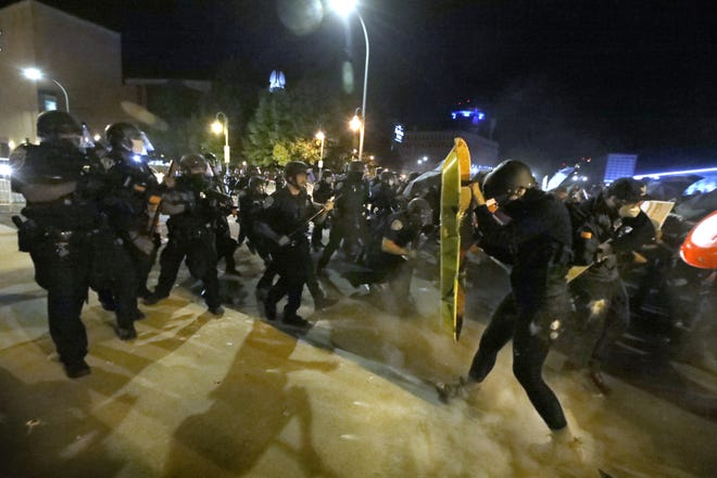 Rochester Police confront Black Lives Matter protesters with pepper balls and tear gas on Court Street as the group tried to march to the Public Safety Building during a Black Lives Matter protest held Friday night, Sept. 4, 2020 in downtown Rochester.
