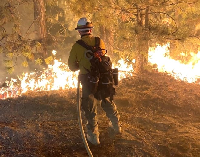 A firefighter on the line in the Elkhorn Fire on Sept. 3, 2020.