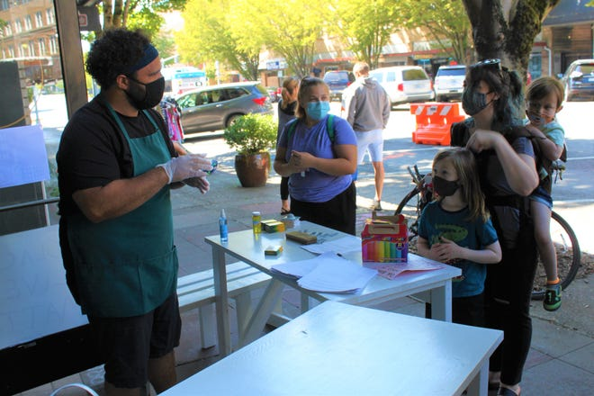 Event organizer Jonathan Jones asked visitors about dietary restrictions during Plates Not Hate, a community building free food event on September 5, 2020.