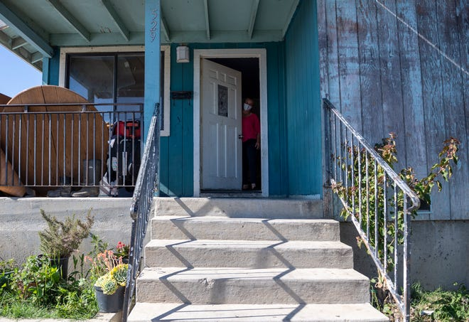 "Eufemia ""Jenni"" Aguilar rents a room in a house in Salinas, Calif. More than five people rent rooms in the same house  because of the high cost of living on the central coast of California."