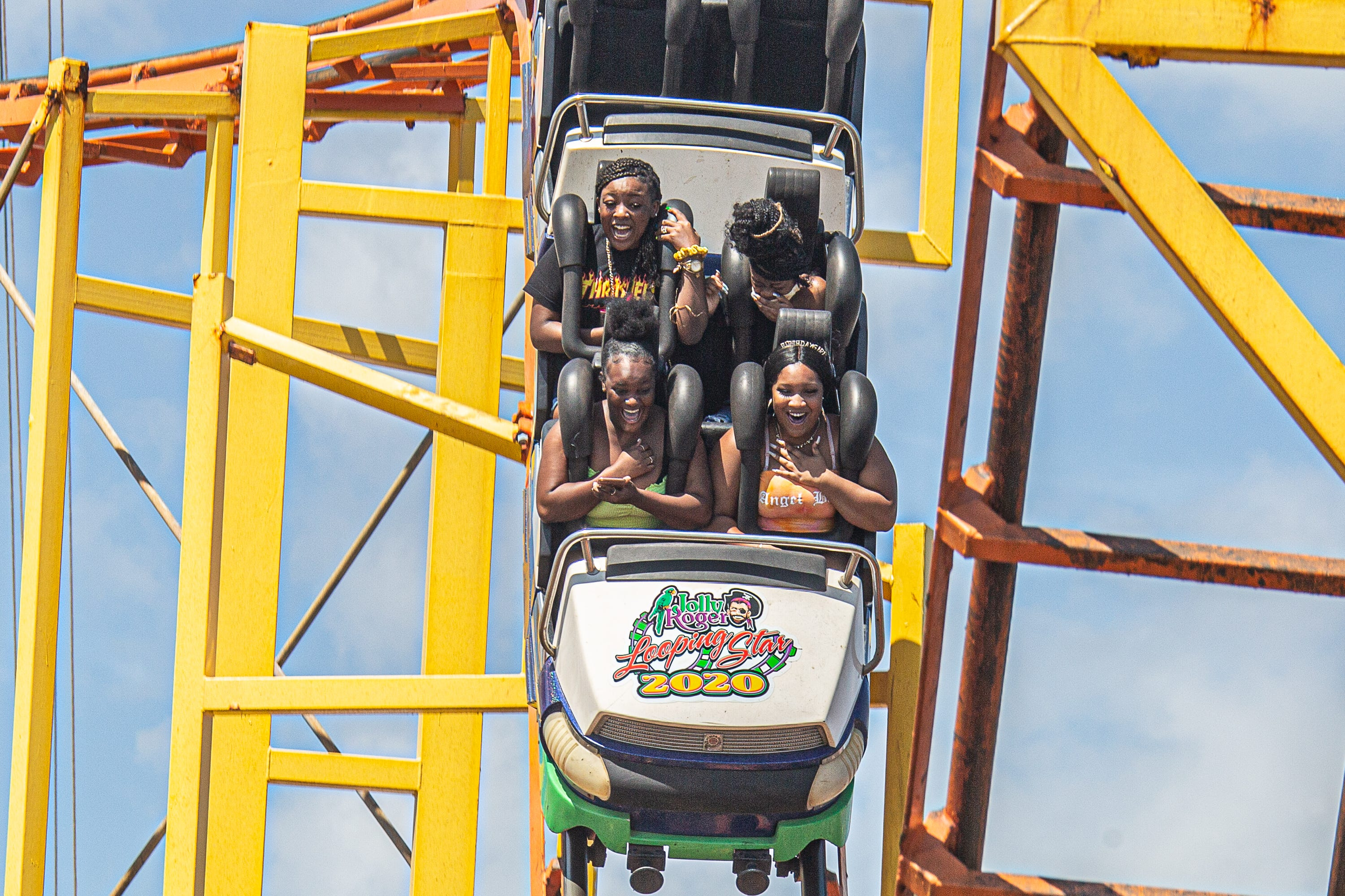Thousands flocked to Ocean City to enjoy Labor Day weekend on the beach and boardwalk. Visitors have fun at Jolly Roger pier rides on Saturday, Sept. 5, 2020.