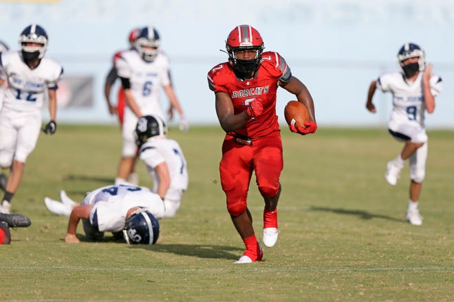 Led by a punishing ground attack and a smothering defense, the Munroe Bobcats mauled the St Johns Country Day Spartans 54-0 to open their 2020 football season.