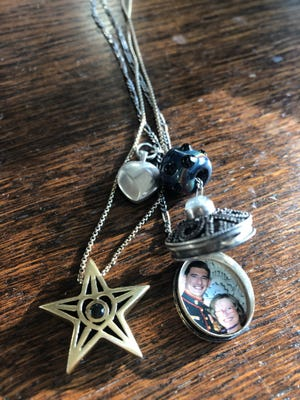 On Mother's Day, Kathryn Steffen, mother of Marine Gunnery Sgt. Diego Pongo from Simi Valley, received a memorial necklace to replace an original locket. The necklace included a gold star, topped with a glass purple bead with Diego's portrait etched inside. Pongo, 34, died March 8, 2020, in the Makhmur Mountains of southern Iraq.