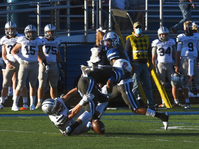 Zanesville's Casey Cassell is stripped of the ball by Granville's Matt Chyakowski in the first quarter of the Blue Aces' 15-8 win at John D. Sulsberger Memorial Stadium. Chyakowski also intercepted a pass to set up a touchdown.