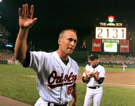 Cal Ripken Jr. waves to the crowd on Sept. 6, 1995, as the scoreboard in center field reads 2,131, signifying Ripken had broken Lou Gehrig's record of playing in 2,130 consecutive games.