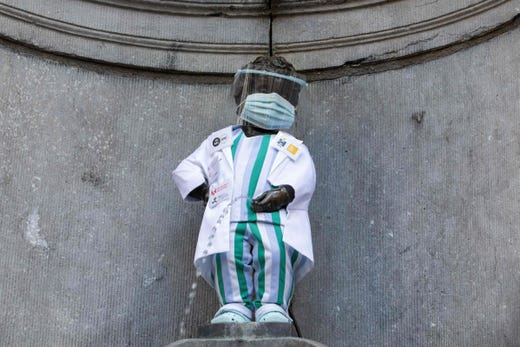 The 'Manneken Pis' statue wears a uniform with a protective mask and face shield to honor the healthcare staff, in Brussels on September 5, 2020.