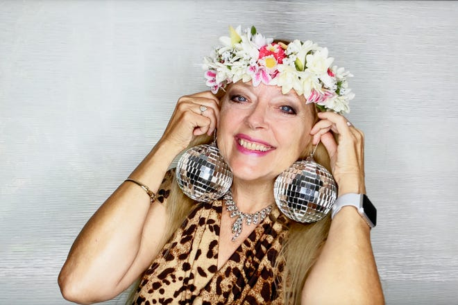 Carole Baskin of Netflix's 'Tiger King,' sporting mirrorball earrings, is one of the celebrity dancers on Season 29 of ABC's 'Dancing with the Stars.'